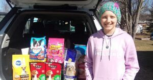 "Young Cancer Patient Spreads ""Pawsitive"" Message To Animal Shelters Across The U.S"